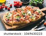 homemade flatbread pizza...   Shutterstock . vector #1069630223