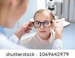 optometrist and little kid in... | Shutterstock . vector #1069642979