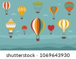 landscape with hot air balloons.... | Shutterstock .eps vector #1069643930
