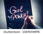 "woman writing ""girl power"" on a ... | Shutterstock . vector #1069654898"
