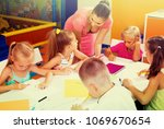 happy spanish  children sitting ... | Shutterstock . vector #1069670654