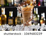 cold coffee drink with ice ... | Shutterstock . vector #1069683239