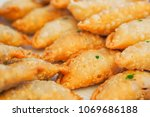 close up of curry puff  | Shutterstock . vector #1069686188