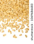 rolled oats texture. scattered... | Shutterstock . vector #1069686683
