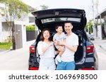happy asian family standing on... | Shutterstock . vector #1069698500