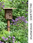 insect hotel for wild bees and ... | Shutterstock . vector #1069707740
