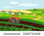 tractor cultivationg a field in ... | Shutterstock .eps vector #1069714244