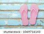 pink beach flip flop on white... | Shutterstock . vector #1069716143