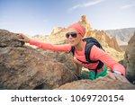 woman hiker reached mountain... | Shutterstock . vector #1069720154