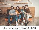 full length portrait of glad... | Shutterstock . vector #1069727840