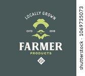 farmer products emblem label... | Shutterstock .eps vector #1069735073