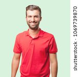 young handsome man  red polo... | Shutterstock . vector #1069739870