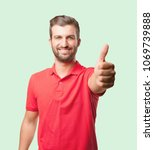 young handsome man okay sign... | Shutterstock . vector #1069739888