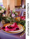 Small photo of Wedding decor of the color of marsala and purple