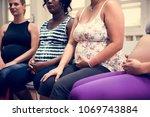 pregnant women in a class | Shutterstock . vector #1069743884