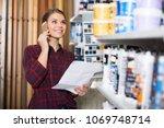 female designer is choosing... | Shutterstock . vector #1069748714
