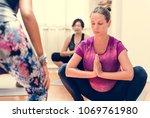pregnant woman in yoga class | Shutterstock . vector #1069761980