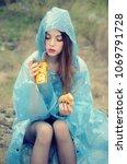 girl in plastic raincoat with... | Shutterstock . vector #1069791728