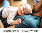 father with a baby girl at home ... | Shutterstock . vector #1069794509