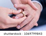 close up wedding rings | Shutterstock . vector #1069799843