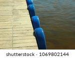 fender of blue tires at a pier | Shutterstock . vector #1069802144