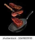 flying pieces of beef steaks... | Shutterstock . vector #1069805930