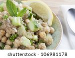 Cooked amaranth seeds with cucumber chickpeas and mint in a tabouli (tabbouleh) style vegan salad. - stock photo
