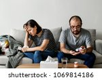 couple sick at home on the sofa | Shutterstock . vector #1069814186
