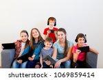kids using different gadgets | Shutterstock . vector #1069859414