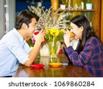 young loving asian couple... | Shutterstock . vector #1069860284