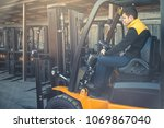 man drives a reliable heavy... | Shutterstock . vector #1069867040