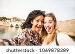 happy multiracial girlfriends... | Shutterstock . vector #1069878389