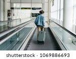 hipster man traveler tourist in ... | Shutterstock . vector #1069886693