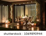Small photo of Summer evenig terrace with candles, wine and lights