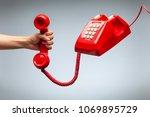 Hand Holding Telephone  Classi...
