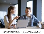 young smiling coworkers woman... | Shutterstock . vector #1069896650