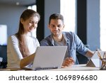 young smiling coworkers woman... | Shutterstock . vector #1069896680