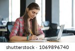 portrait of a serious woman... | Shutterstock . vector #1069896740