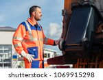 garbage collection worker... | Shutterstock . vector #1069915298