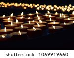 burning memorial candles on the ... | Shutterstock . vector #1069919660