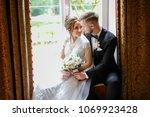 newlyweds in the interior.... | Shutterstock . vector #1069923428