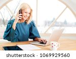 beautiful smiling mature... | Shutterstock . vector #1069929560
