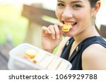 business woman eating peanut... | Shutterstock . vector #1069929788