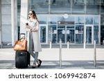 business woman standing near... | Shutterstock . vector #1069942874