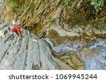 female model enjoying in nature.... | Shutterstock . vector #1069945244