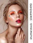 beautiful girl with art make up ... | Shutterstock . vector #1069945490