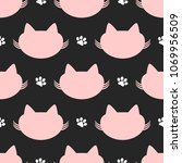 repeated silhouettes of cat... | Shutterstock .eps vector #1069956509