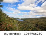 a blue sky with white puffy... | Shutterstock . vector #1069966250