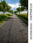 asphalt road with trees | Shutterstock . vector #1069968110
