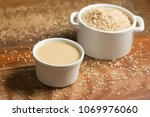 tahini in a bowl over a wooden... | Shutterstock . vector #1069976060
